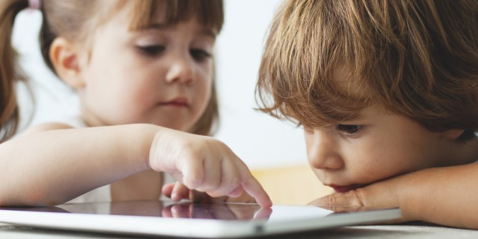 Small kids using a tablet