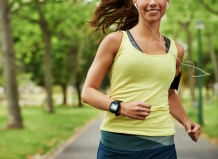 Cropped shot of a sporty young woman listening to music while running outdoors