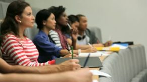 stock-footage-group-of-students-taking-notes-in-lecture-theater(1)